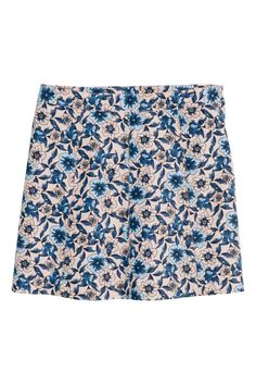 Short skirt: Short, gently flared skirt in woven fabric with a concealed zip in the side.