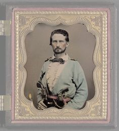 Title: Unidentified soldier from Kentucky in Confederate uniform with two revolvers.    Medium: 1 photograph : sixth-plate ambrotype, hand-colored ; 9.7 x 8.8 cm (case)    Liljenquist Family Collection of Civil War Photographs; Ambrotype/Tint