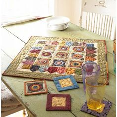 Scrappy Floral Applique Table Mat  Raid your stash to make this table mat and matching coasters. Add a personal touch by finishing this project with large, hand-quilted stitches.  Get patterns and instructions for the Scrappy Floral Applique Table Mat.