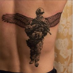 Back-piece memorial of a fallen soldier (R.I.P.) in stylized realism done by Angel Antonio Morillas in 2014.   Chicago, Illinois