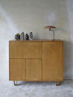 Cees Braakman cabinet 1952. Louis Kalff table lamp for Philips, Netherlands, 1960.