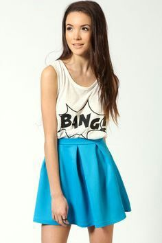 Using a graphic tee or tank top to dress down a skator skirt? Genious!!!!