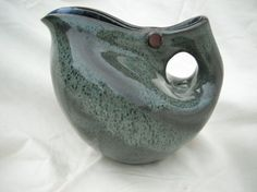 Altered blue pitcher by Grisen Studio