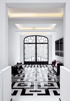 The geometric marble floor is patterned to reflect the custom-designed metal door by Pierre Yovanovitch. Very Art Deco Home Interior, Interior Architecture, Interior And Exterior, Interior Design, Bathroom Interior, Modern Bathroom, Art Deco, Art Nouveau, Decorating Blogs