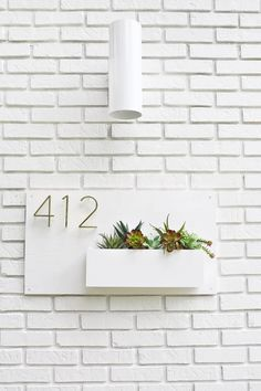 Be still my heart! Look at this modern, DIYable house number planter!!!