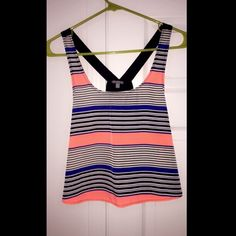 Charlotte Russe razorback crop top Charlotte Russe razorback crop top. Striped patterned with black and neon colors. Size small but feel like runs a little big and would fit medium better. Worn once. Like new condition. No known defects. PET FREE, SMOKE FREE home. Charlotte Russe Tops Crop Tops