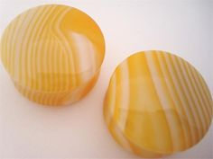 """Yellow Agate Stone Plugs  Just bought these in 0g! The specific pair I got are supposed to be """"mostly dark yellow"""". I'm excited to see them."""