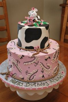 Cow Birthday Cake IMBC icing and piping; fondant rope border, cow patches and topper. Request was for 2 tier cow cake- top being cow print...