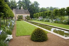 A silvery 100-foot-long canal slices the main garden at Gloucestershire's Temple Guiting