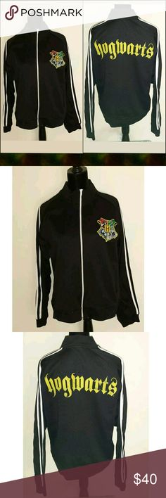 """REDUCED⬇Harry Potter Hogwarts Zip Track Jacket * * * Good pre-owned condition: Metal corner of zip has detached a little from fabric at the bottom. Still zips up properly. * * *  Harry Potter  Warner Bros.  Hogwarts written in gold colored letters on back of jacket  Crest on left chest area  2 front pockets  Adult  Track Jacket  Full Zip  Size: Large  Approx. Measurements: Pit to pit- 21.5""""/Pit to end of sleeve- 22""""/Top of shoulder to bottom hem- 25.5""""  Black/White  100% Polyester  Smoke and…"""
