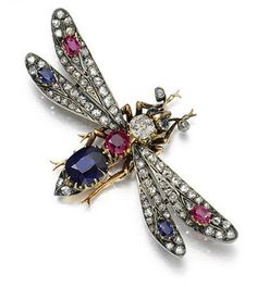 """Ruby, sapphire and diamond brooch, late 19th century.   Designed as a winged insect, set with oval and cushion-shaped sapphires and rubies, circular-cut and rose diamonds, French assay marks, detachable brooch fitting, pendant loop, sprung hair fitting, fitted case, accompanied by a hand-written note from Queen Alexandra """"With all good wishes for every happiness to good luck from Alexandra."""""""