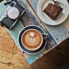 love the combination of the table and coffee /  taken at timberyard cafe in London