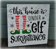 12 x 12 wood sign. It reads: This house is under elf Surveillance. All signs are hand painted or stained, sealed and include a sawtooth hanger on the back. Please allow up to 5 business days (Monday - Friday) for your sign to ship. Holiday Signs, Christmas Signs, All Things Christmas, Christmas Decorations, Elf Decorations, Funny Christmas, Christmas Wood, Christmas Projects, Winter Christmas