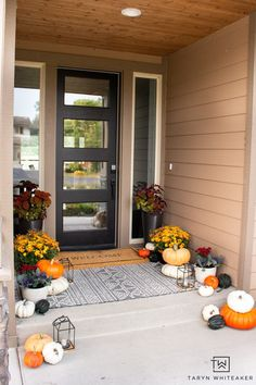 This Earth Tone Fall Porch is full of traditional fall colors but also has a nice modern look to it. Love all the orange mums and heirloom pumpkins. Mums In Pumpkins, White Pumpkins, Black Lantern, Fall Planters, Black Doors, Back Patio, Small Plants, Cool Diy Projects, Earth Tones