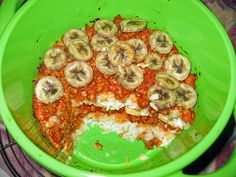 Rice casserole with minced meat and bananas - Served in the plastic bucket that can after dinner be used as barf bag.