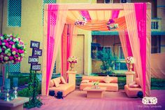 pink and gold tent, drapes decor, floral decor