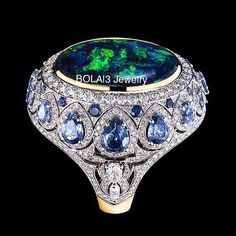Black Opal Ring with diamonds and sapphires