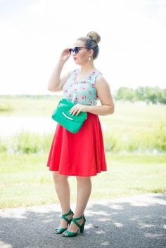 This fashion blogger brings out her fun style with one of this Summer's hottest fashion trends, the cutest watermelon shirt and red midi skirt! Her chic summer style is topped off with the best top bun and green accessories!: