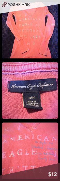 AEO v-Neck Long Sleeved t-shirt A slim fitting, long-sleeved v-neck t-shirt by American Eagle 🦅 Outfitters.  A soft cotton that is lightweight and a light raspberry color.  Cuffed sleeves.  Distressed by nature.  Wear in layers or on its own. Size M.  Excellent used condition. American Eagle Outfitters Tops Tees - Long Sleeve