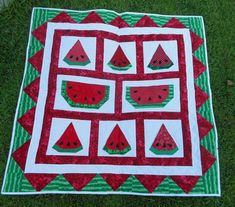 Love this watermelon quilt - link goes to the photo, but no further information is provided.  Would be really cool if the watermelon triangles in the border ... were made from prairie points :D