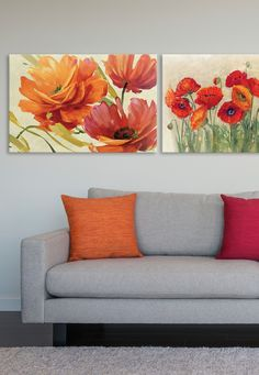 "Lisa Audit's ""Flamboyant III"" and Carol Rowan's ""Vibrant Poppies"" red and orange art prints meld together to showcase gorgeous contemporary floral designs that are both brilliant and inspiring. These floral canvases add a perfect accent to a living room, guest room or office. Available for purchase at GreatBIGCanvas.com."