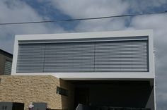 Retractable Louvres and Blinds photo gallery House Facades, Facade House, Exterior Blinds, Security Solutions, Flat Roof, Modern Houses, Sun Shade, Window Coverings, Venetian