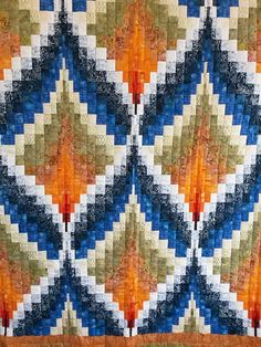 This beautiful bargello quilt, Diamond Flame, is a Queen measuring 103″ x 112″. It is hand quilted by a local Mennonite woman is shades of blue, orange and green. The... Read More