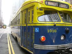 Double-ender PCC streetcar No. 1010, painted in the 1939 colors of the San Francisco Municipal Railway, on Market Street, San Francisco Milan streetcar 1818 is visible to the left.