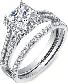 Sylvie Split Shank Halo Diamond Engagement Ring  : This diamond engagement ring setting by Sylvie features round brilliant cut diamonds pave set along a split shank leading up to a double row halo accentuating the center stone of your choice.  my ring.