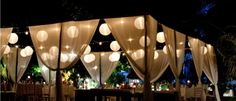 Wedding Decoration Ideas, Night Outdoor Wedding Reception Decorations With Hanging Curtains And Small Chinse Lanterns Also Square Tables Plus Wooden Chairs: The Pretty Decorations for Outdoor Wedding Reception