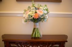 Coral' Miss Piggy ' roses , with peach Juliet David Austin roses with daises , stocks and cream roses , wedding , brides bouquet ,natural , rustic handtied