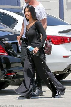 Feeling nippy... Kourtney Kardashian was spotted leaving an LA studio on Friday dressed in a very revealing black top