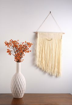 """Off White / Cream Modern Macrame Wall Hanging Tapestry on Wood Bar w/ Brass Accent.  The """"Vintage Modern"""" Macrame Wall Hanging Collection is inspired by my love for mid century modern and contemporary design. There is nothing wrong with mixing the old with the new! The pieces in this collection are so versatile that they would be a great accent to any space or decor style.  Size: Large Materials: 100% wool fibers  Dimensions: 18""""w x 30""""h Total height with string: 36""""   www.astralriles.com"""