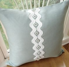 Spa blue linen pillow cover appliqued with white rick-rack and shell beads…