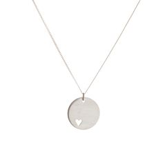 Dear Rae Jewellery | Silver disc pendant. A sterling silver disc, with a small heart shape cut out, on a silver chain.