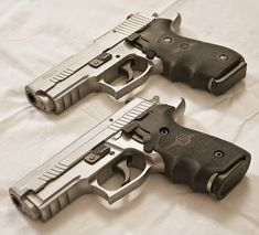 Sig Sauer P229 Elite Stainless and a P220 Carry Elite Stainless with Hogue grips.