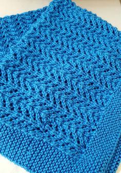Free Knitting Pattern for 4 Row Repeat Lace Baby Blanket - The Pine Forest baby blanket features a 4 row repeat gull lace stitch. Designed by Ingrid Aartun Bøe Pictured project by rvespinosa