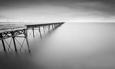 """https://flic.kr/p/tAH2Mh   Endless.   Minimal take on Queens Pier, Ramsey, Isle of Man.   The very impressive but sadly now abandoned 2241 foot pier was built for the Isle of Man Harbour Board, It opened on 22nd July 1886.  You can view my most interesting shots on Flickriver here: <a href=""""http://www.flickriver.com/photos/pete37038/popular-interesting/"""" rel=""""nofollow"""">www.flickriver.com/photos/pete37038/popular-interesting/</a>."""