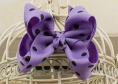 Handcrafted Polka Dot Boutique Bow. Dark Orchid Purple hair bow with dots.
