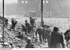 German soldiers advacing in a street during Warsaw uprising