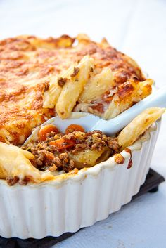 Greek Pastitsio with Pasta, Ground Beef, Galic, Oregano, Nutmeg, and Chopped Tomatoes