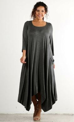 A modest womens hi-lo draped dress with side pockets, round neckline and long sleeves.