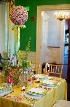 Dum-dum topiary, puzzle place-mats, mason-jar sippy cups, and goodie-bags filled with (more) candy, games, and the like.