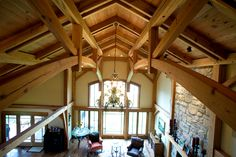 The great room of a rural Pennsylvania home showcases two parallel chord trusses with curved bottom chords.
