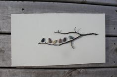 this is sooo cute! made from pebbles and twigs! I think I could do this!