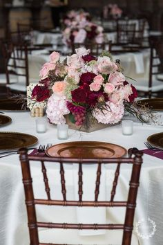 burgundy and blush floral centerpieces look very fall like and lush