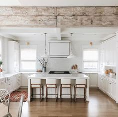 Rustic beam in white modern farmhouse kitchen