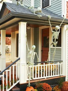 Skeletons on the front porch--secured with fishing line.