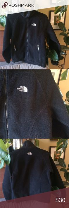 North Face Fleece Jacket Gently used black North Face fleece jacket, size small. Very warm and cozy, perfect for fall! Has 2 secure-zip hand pockets and a hem cinch-cord to make the bottom tighter. Can fit XS-Small. North Face Jackets & Coats