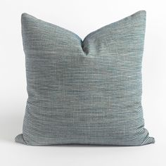 This striped sea glass blue and light flax pillow is both classic and elegant. It's the perfect alternative to a solid pillow and will add an interesting layer to your space thanks to the simple, fine stripe in low-pile watery blue chenille. The natural sand-colored backdrop has a linen-like slub with variation, which adds to the casual character. Condo Living Room, Large Sofa, Basket Tray, Dash And Albert, Handmade Pillows, Sheer Fabrics, Sea Glass, Decorative Accessories, Fabric Design
